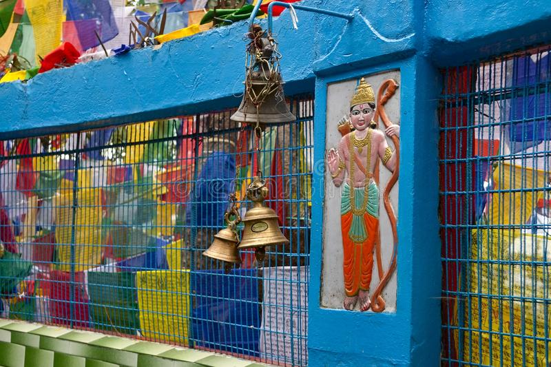 Hindu and buddhist religious symbols, prayer flags and bell. Mahakal temple on the Observatory hill, hindu and buddhist religious symbols, prayer flags and bell stock images