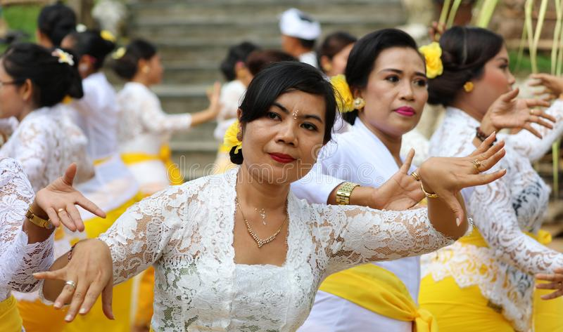 Hindu celebration at Bali Indonesia, religious ceremony with yellow and white colors, woman dancing. Culture dance stock photos