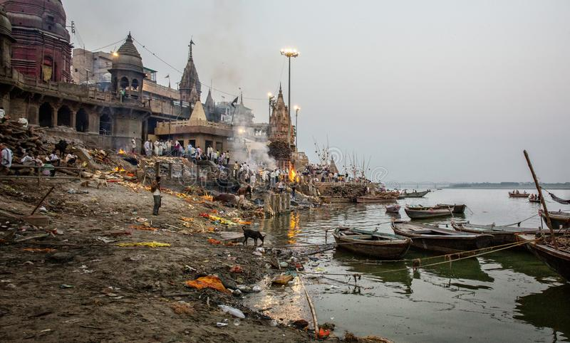 Hindu cremation ceremony at Manikarnika Ghat on banks of holy Ganges river. Varanasi Uttar Pradesh India. Hindu cremation ceremony at Manikarnika Ghat on banks royalty free stock photos