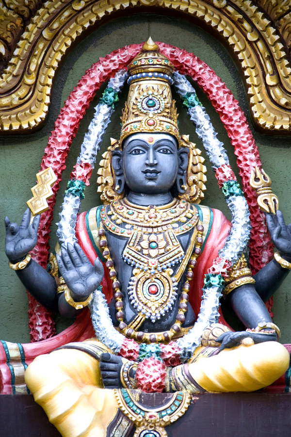 Hindu Deity. Image of a Hindu diety sculptured out of stone stock photo