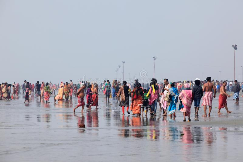Hindu devotees gathered to take a holy bath in the river Ganges on the day of `Makar Sankranti` royalty free stock images