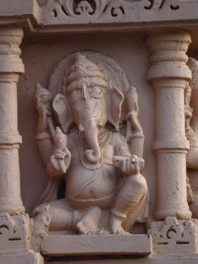 Hindu god ganesh on Old pillar. Hindu god Ganesh form frount effect. Historical pillar having old cultural designs depicting rich and diverse history of India royalty free stock photo