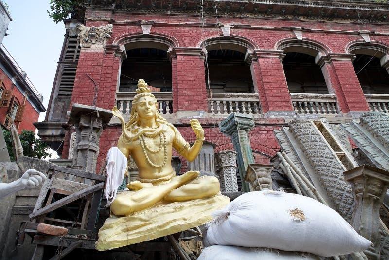 Hindu God in Kumortuli, Kolkata, India. Clay idols of Hindu Gods in Kumortuli, the traditional potters' quarter in northern Kolkata, West Bengal, India. This stock image
