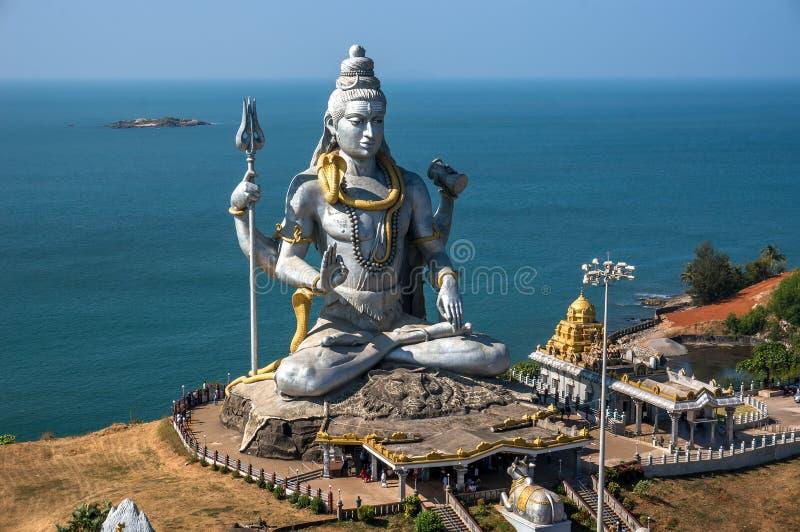 Hindu god statue, lord Shiva sculpture sitting in meditation India, 2011 stock photo