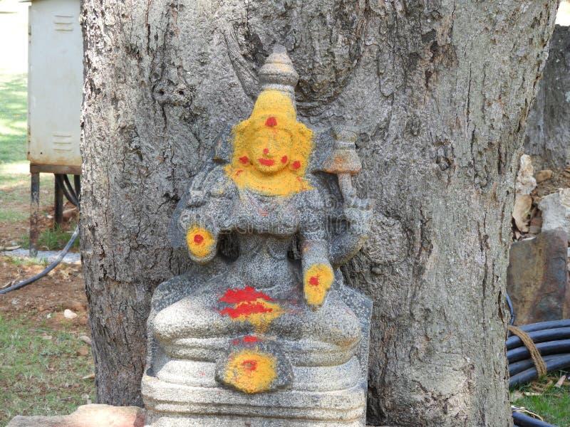 Hindu goddess under the tree in park royalty free stock photos