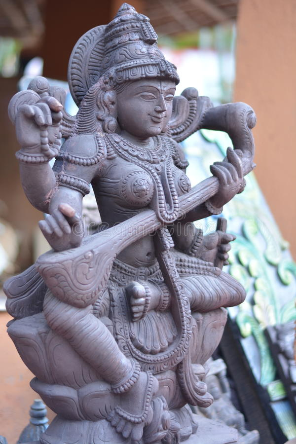 Hindu goddess-saraswati. Goddess of enlightment and knowledge - saraswati with veena carved out of stone stock image