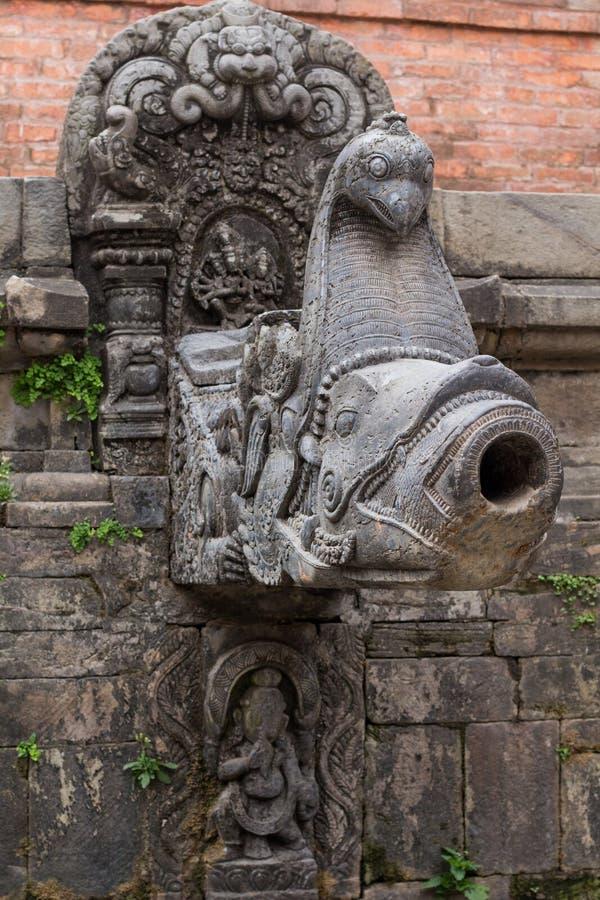 Hindu Goddess Statue water Tap stock photo