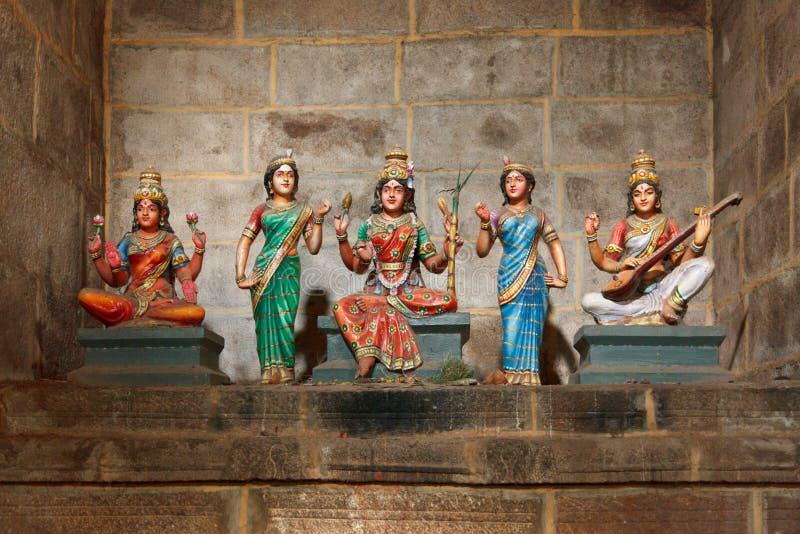 Hindu goddesses Parvati, Lashmi. And Saraswati statues in Rock temple. Tiruchirappalli, Tamil Nadu, India royalty free stock images