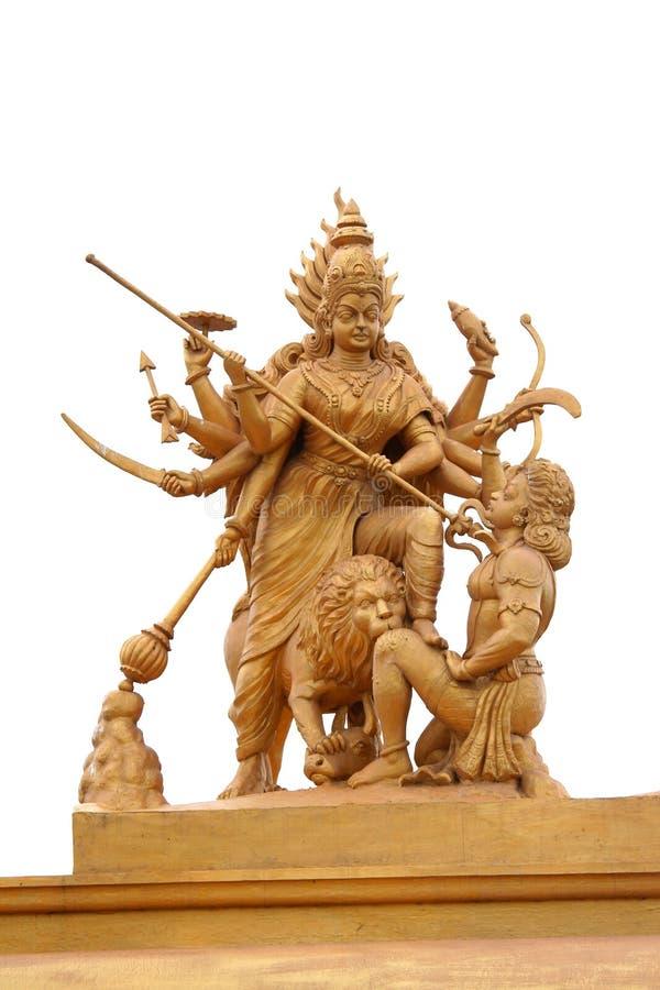 Hindu godess Kali. Powerful hindu godess Kali statue in golden color stock photography