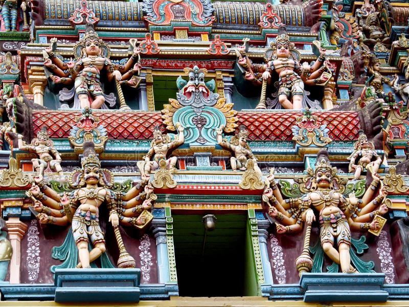 Hindu gods statues. Colored hindu gods statue on the wall of hinduist temple with ornament and decorations. Man and woman figure, statues of hindu gods and stock photos