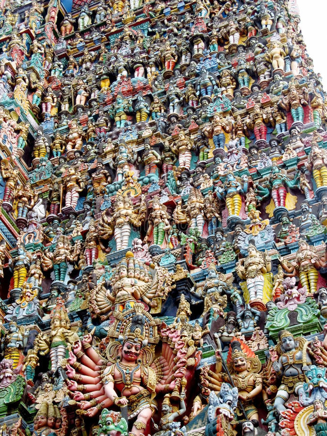 Hindu gods statues on gopuram. Colored statue on the wall in front of the entrance to the hindu temple with ornament and decorations. Man and woman figure royalty free stock image