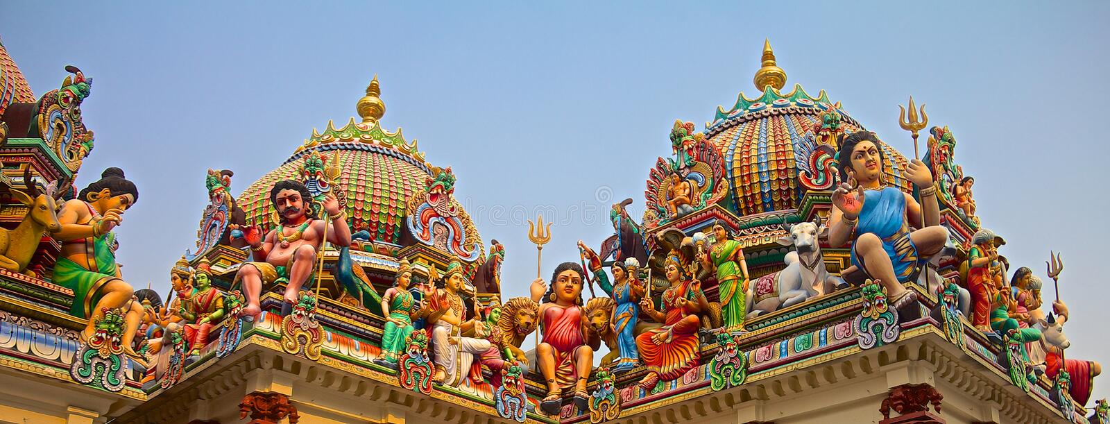 Hindu gods on a temple roof stock photography