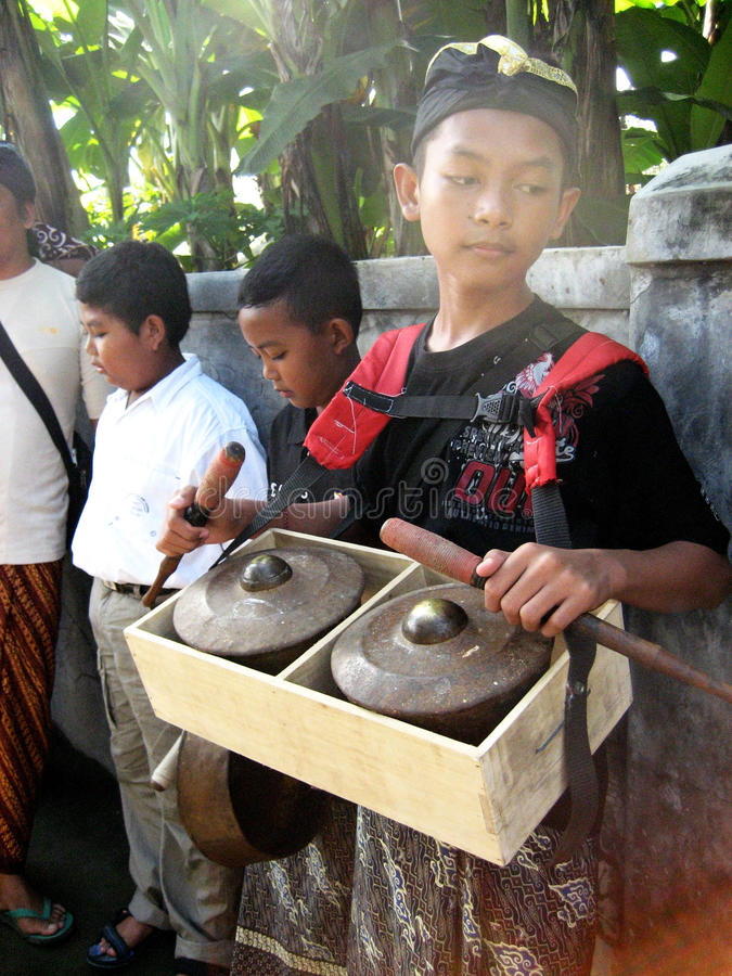 Hindu music. Children play religious music before the Hindu rituals in a village in Klaten, Central Java, Indonesia royalty free stock images