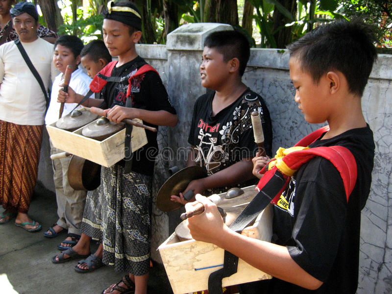 Hindu music. Children play religious music before the Hindu rituals in a village in Klaten, Central Java, Indonesia stock photo
