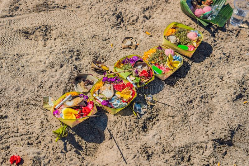 Hindu offerings and gifts to god on the beach in Bali, Indonesia stock image