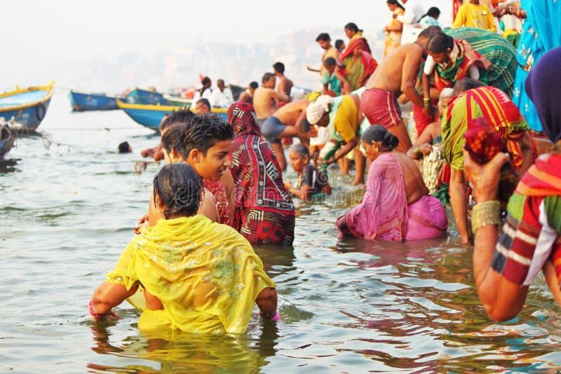 Hindu pilgrims taking bath at Varanasi stock photography