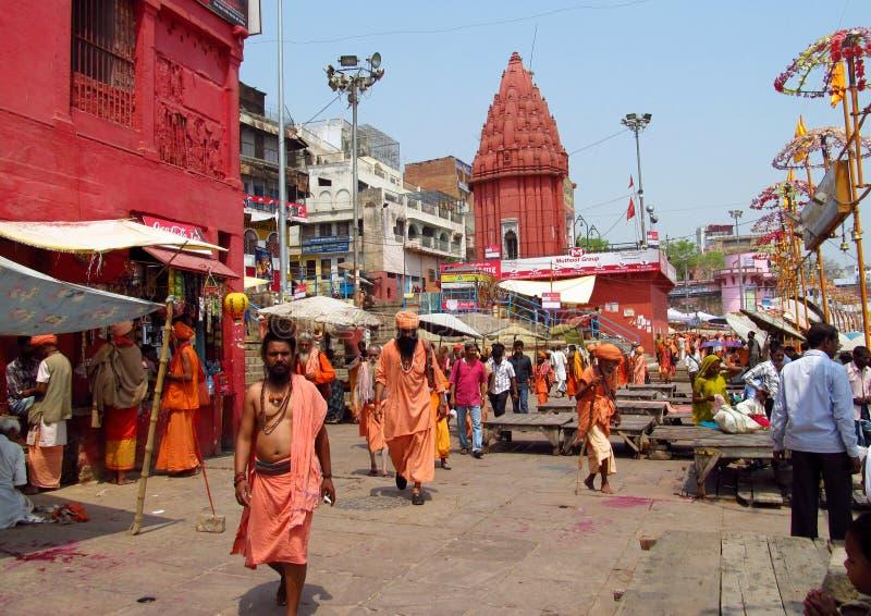 Hindu piligrims in orange clothes in Varanasi stock photography