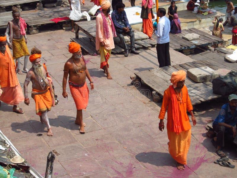 Hindu piligrims in orange clothes in Varanasi royalty free stock photography