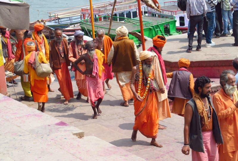 Hindu piligrims in orange clothes in Varanasi royalty free stock photo