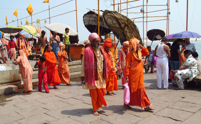 Hindu piligrims on the street in India stock photography