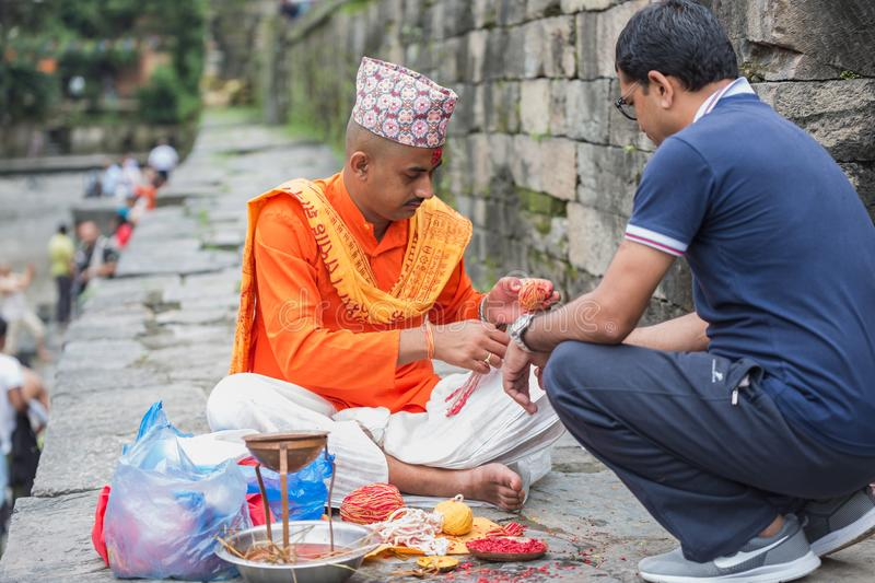 Hindu Pople Receiving Raksha Bandhan at Pashupatinath Temple in royalty free stock images