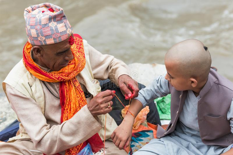 Hindu Pople Receiving Raksha Bandhan at Pashupatinath Temple in royalty free stock image