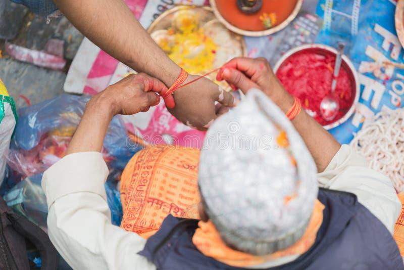 Hindu Pople Receiving Raksha Bandhan at Pashupatinath Temple in royalty free stock photos