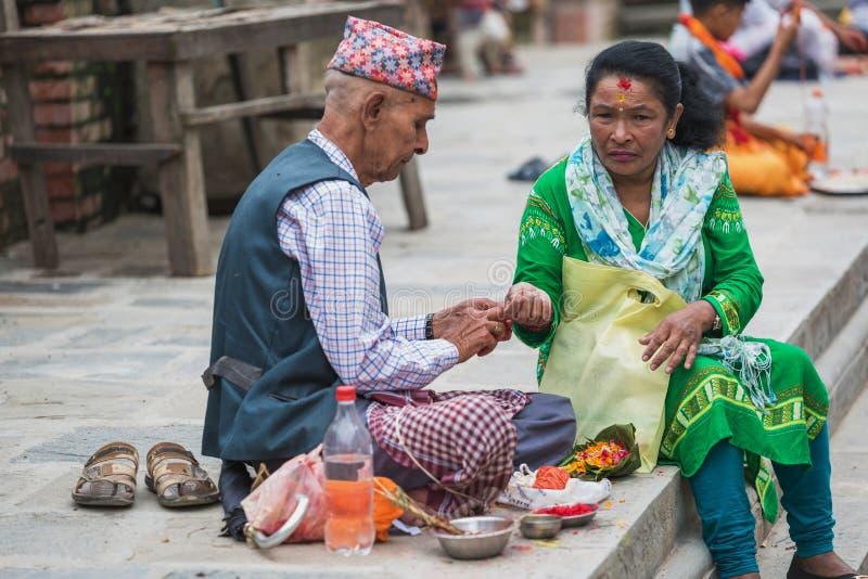 Hindu Pople Receiving Raksha Bandhan at Pashupatinath Temple in stock images