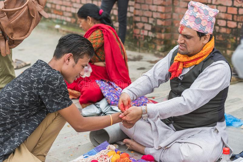 Hindu Pople Receiving Raksha Bandhan at Pashupatinath Temple in stock photos