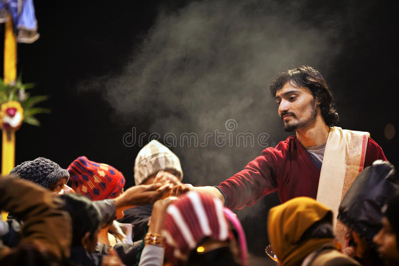 Hindu priest during Ganga Aarti ceremony stock photography