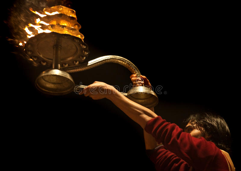 Hindu priest during religious Ganga Aarti ceremony stock photo