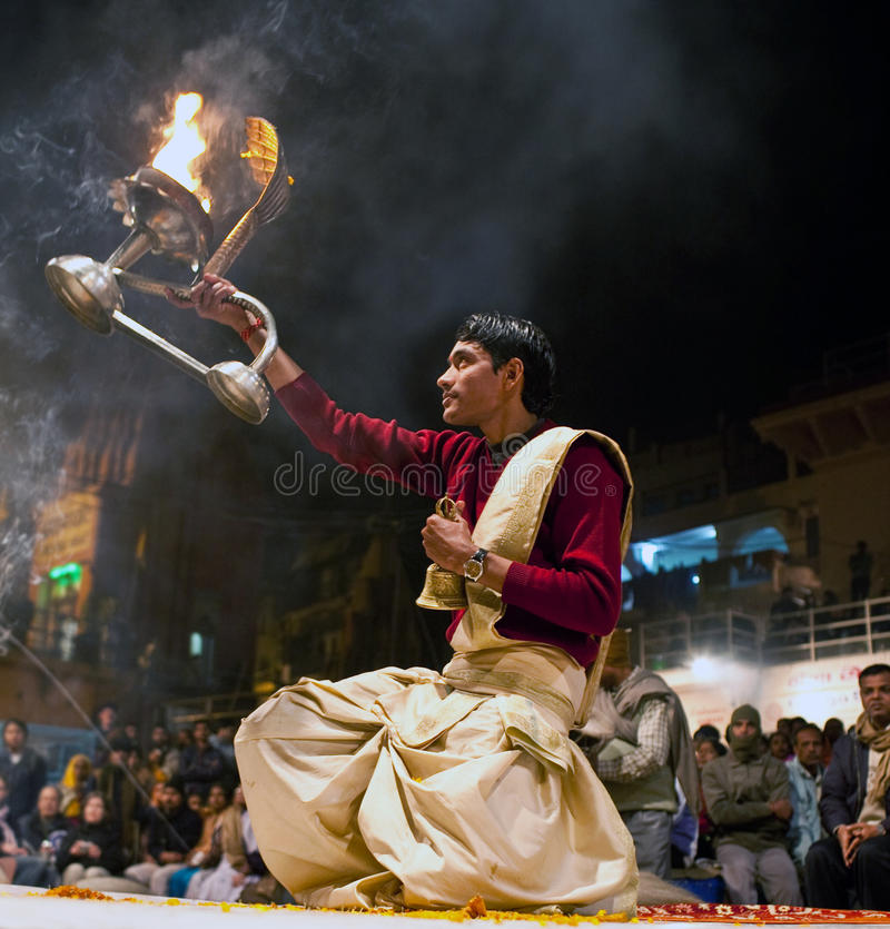 Hindu priest during religious Ganga Aarti ceremony. VARANASI - JANUARY 14: Hindu priest during religious Ganga Aarti ceremony at Dashashwamedh Ghat on January 14 royalty free stock images