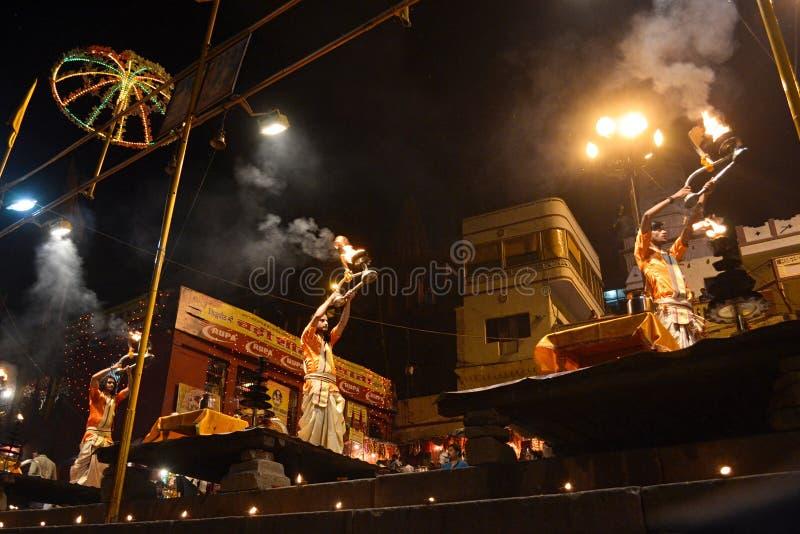 Hindu priests performing religious Ganga Aarti ritual. Varanasi, India - April, 2014: Hindu priests performing religious Ganga Aarti ritual fire puja royalty free stock photos