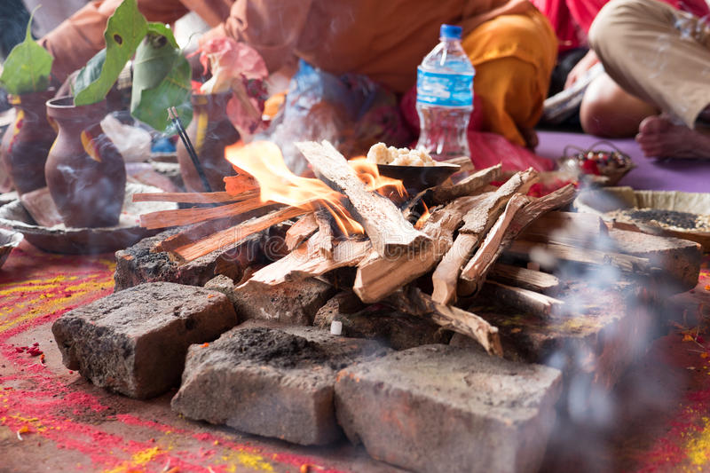 Hindu puja in Temple Kathmandu. Puja or Poojan is a prayer ritual performed by Hindus to host, honour and worship one or more deities, or to spiritually stock photo