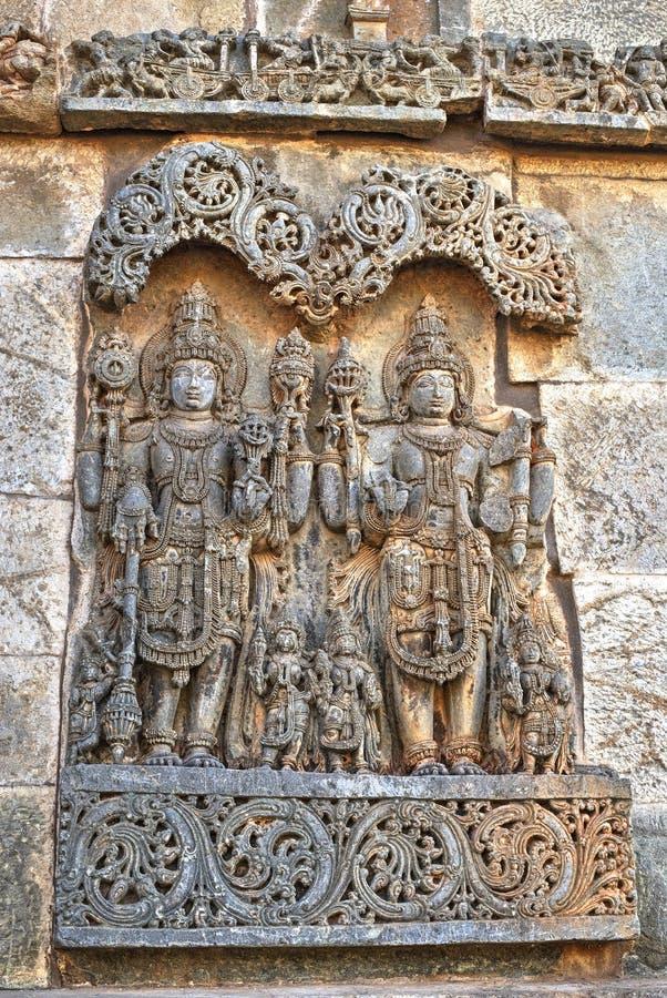 Hindu sculpture, Bellur, India. Hindu sculpture depicting Jaya and Vijaya, the two demigods and the gatekeepers of the Vishnu abode, known as Vaikuntha, place of stock photography