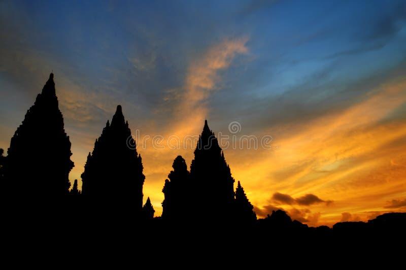 Hindu temple. Dramatic sky with sun setting at Hindu temple Prambanan. Indonesia, Central Java, Yogyakarta stock photo