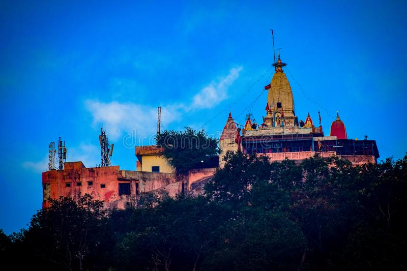 Hindu temple over a mountain. Temple on the hill. Temple in India stock photos