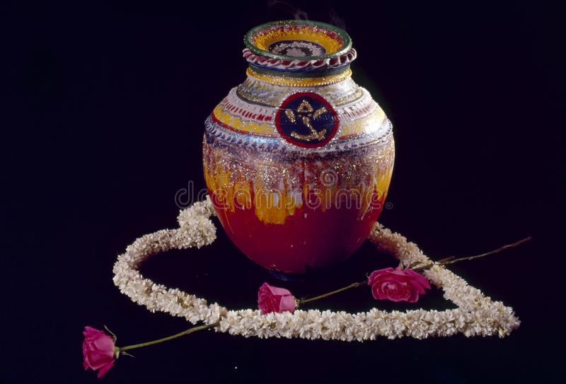 Wedding ceremonial decorated pot with sweets fillings for the bride. Hindu Wedding ceremonial decorated pot given to the bride filled with sweets & goodies stock photography