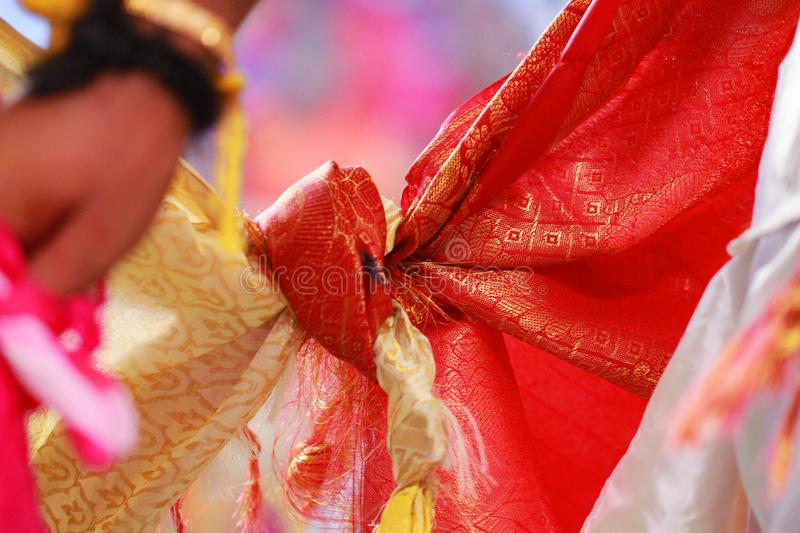 Closeup Hindu wedding knot tied with man and woman dress. Hindu wedding knot with man and woman dress royalty free stock photography