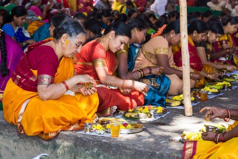 Hindu women making a ritual offering. royalty free stock photo
