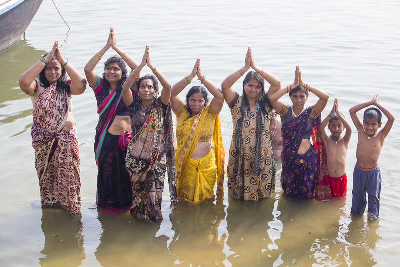 Hindu women pilgrims take bath in the Holy river Ganges . Varanasi, India stock photos