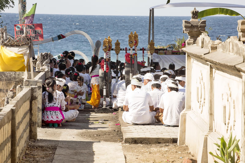 Hindus in prayers, - Nusa Penida, Indonesia royalty free stock images
