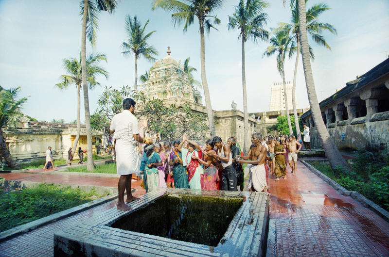 Hindus are washed from the sacred well stock photos