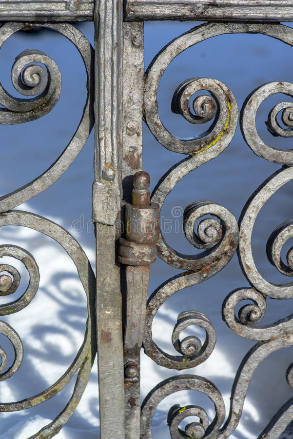 Hinge of an ancient gate stock photography