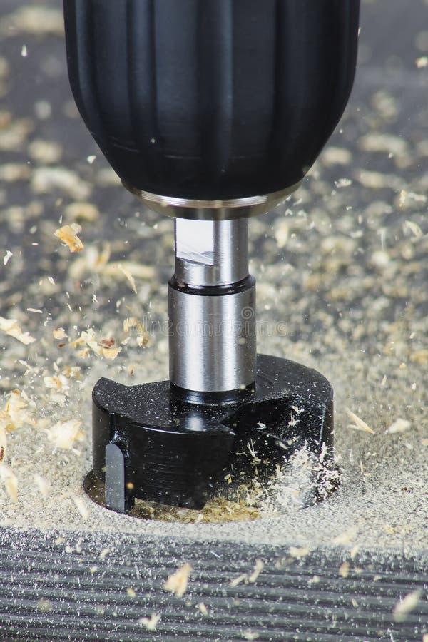 Hinge bit drilling stock photo
