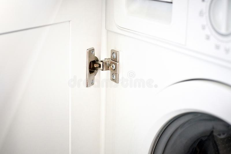 Hinge Kitchen assembled on white doors, steel. royalty free stock image