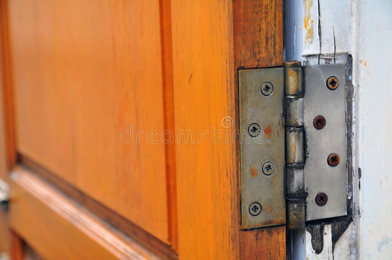 Hinge on old wooden door royalty free stock photography
