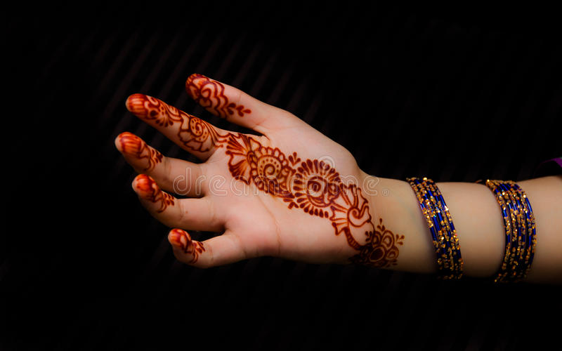 Hinna tattoo on hand and bangles. Hinna is used on Festivals and events in asia royalty free stock images