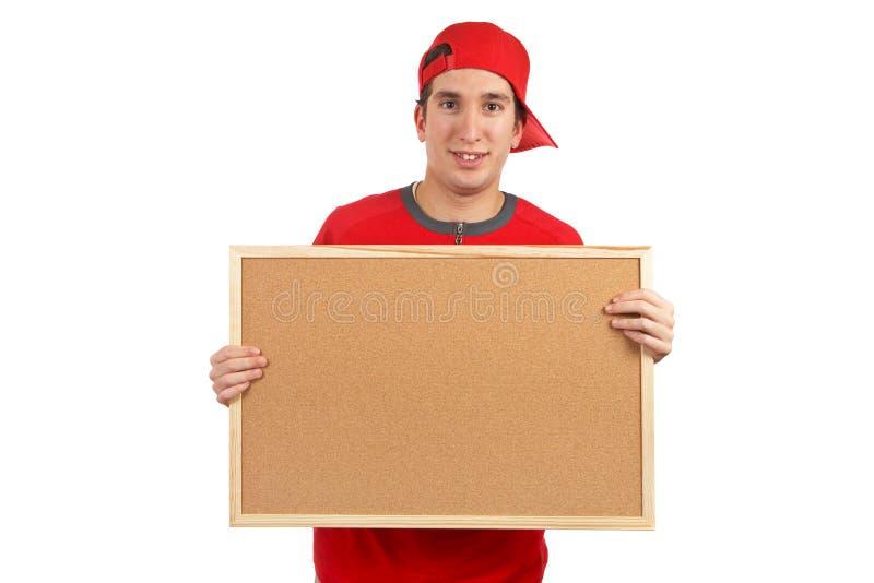 Hinter dem leeren corkboard lizenzfreie stockfotografie
