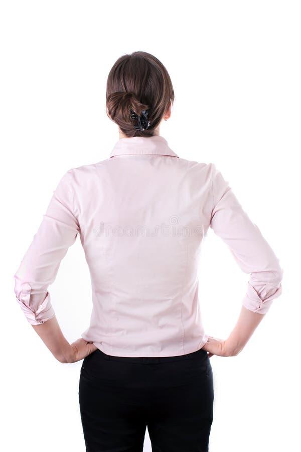 Hintere Ansicht der durchdachten Geschäftsfrau, die, lokalisiert auf Weiß erwägt. stockbilder